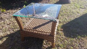 glass and rattan table in Wilmington, North Carolina