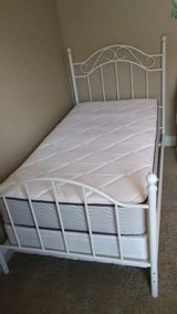 Twin white iron bedframe with mattress and box spring in Lake Charles, Louisiana