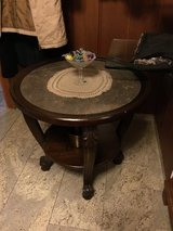 Antique round side table dark wood and stone top in Ramstein, Germany