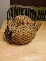 Iron and wicker teapot in Naperville, Illinois