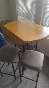 Table with two stools in Fort Carson, Colorado