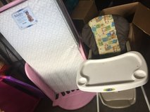 Evenflo high chair and a toddler pink bed with matress in Fort Lewis, Washington