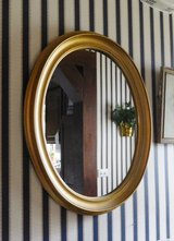 Framed oval mirror gold tone frame in Glendale Heights, Illinois