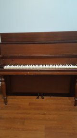 Antique Upright Piano in Fort Campbell, Kentucky