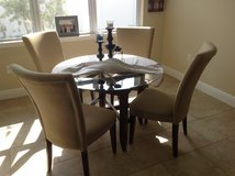 Round glass table with 4 cushion back chairs in Saint Petersburg, Florida