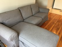 Grey sofa couch with chaise in Saint Petersburg, Florida