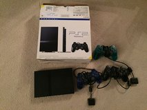 PS2 console and 3 controllers in Elgin, Illinois