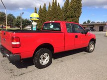 $ 4950- Brilliant fire engine red, 2005 FORD F-150 pickup truck, new bed liner in Fort Lewis, Washington