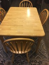 Table and six chairs in Naperville, Illinois