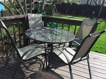 Patio table and four matching chairs in Naperville, Illinois
