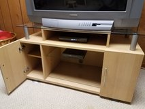 Wood and glass TV stand in Lockport, Illinois