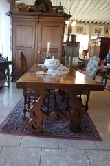 unique solid oak dining table with wrought iron decorations underneath in Wiesbaden, GE