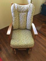 Solid oak glider rocking chair in Conroe, Texas