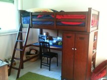 loft bed with desk, armoire and deep shelves for storage in Fairfield, California