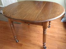 Oak drop leaf table in Chicago, Illinois