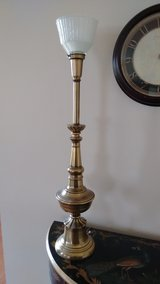 Tall brass lamp with glass globe in Lockport, Illinois