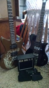 Two First Act Electric Guitars With Amp and Shoulder Strap in Fort Lewis, Washington