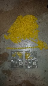 54 feet of yellow plactic chain and 2 unopened 10 packs of yellow plastic 1 1/2 inch S-hooks in New Lenox, Illinois