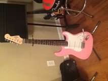 Electric guitar pink and white in Fort Campbell, Kentucky