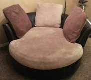 brown leather swivel chair w 3 pillows.. in Fort Campbell, Kentucky