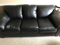 Black leather couch in Perry, Georgia