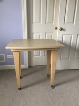 Light wood table with wheels in Naperville, Illinois