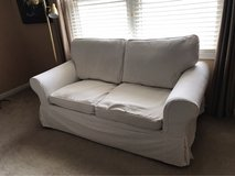 Down-filled Loveseat with 2 Sets of Slip Covers in Bolingbrook, Illinois