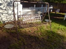 Outdoor metal swing with two side tables in Warner Robins, Georgia