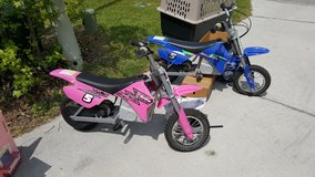 2-Razor dirt bikes- blue or pink with helmets-MX350 in Camp Lejeune, North Carolina