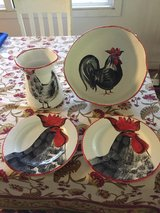 Rooster plates, bowl, and utensil crock in Honolulu, Hawaii