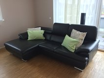 Designer leather couch and ottoman. in Stuttgart, GE