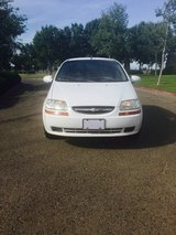 white Chevrolet hatchback in Lemoore NAS, California