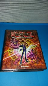 Yu gi oh album (used) with 82 cards in Batavia, Illinois