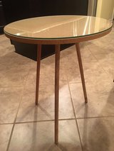 Round table with glass in Baytown, Texas