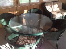 Green metal table and four chairs in Glendale Heights, Illinois