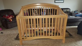 Beautiful Simmons oak crib/toddler bed in Fort Campbell, Kentucky