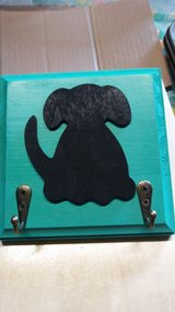 Wooden dog leash holder in New Lenox, Illinois