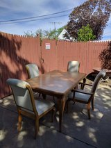 solid oak wood table with 4 comfy chairs in Shorewood, Illinois