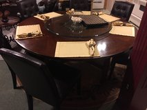 Big dinning table with leather chairs in Clarksville, Tennessee
