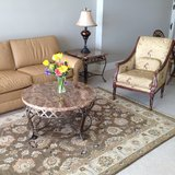 Living room couch, end tables, coffee table, rug in Tampa, Florida