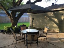 Patio table 4 chairs and umbrella in CyFair, Texas