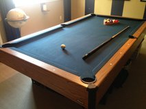 SLATE POOL TABLE, POOL CUE STICKS, RACK, BALLS, CHALK POWDER BLOCK in Kingwood, Texas