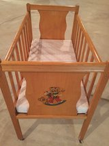 Vintage wooden doll crib in Glendale Heights, Illinois