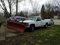 White pickup truck with snow plow in Naperville, Illinois
