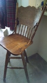 Tall antique oak bar stools 50 inches tall in Fort Carson, Colorado
