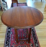 Cherry drop leaf end table. in Naperville, Illinois