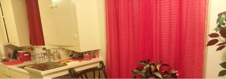 Red sheer curtains in Sugar Land, Texas