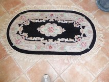 Oval Throw Rug with Fringe - Black Background in San Clemente, California