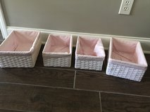 Four white baskets with pink liners in Perry, Georgia