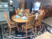 Oak table with 6 press back chairs in Camp Lejeune, North Carolina